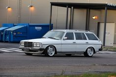 benz wagon...with dumpsters in the background. Nice photo composition