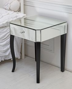 A stylish and unique mirrored single drawer side table with crystal drawer knob. This stunning bedside table combines mirrored glass with a wooden frame, and will sit elegantly in any bedroom. This single drawer side table is part of our mirrored collection and is sure to bring sophistication into your home. Some assembly required.