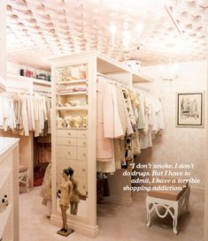 Pink tufted ceiling in the closet of Mindy Weiss, as featured in O at Home Magazine #closet #dressing_room