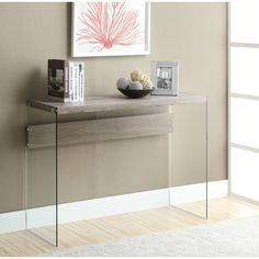 This tempered glass sofa table is a perfect way to accent your hallways and highlight photos or other crafts. Highlighted by its reclaimed, neutral look, this table is a fantastic addition to your home.