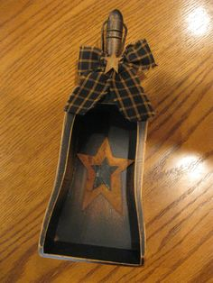 Scoop, this is nice,  but I have an old rusty metal one that would look great with a painted star and ribbon.  Gotta dig it out and do it!