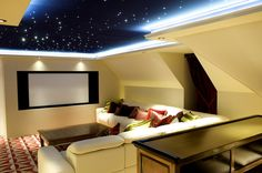 The dramatic design of the cinema room is the star feature of the house