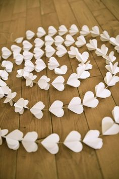 @Jessica Black  Check this out- it looks like 3 cutouts layered together.  Paper hearts garlands WHITE HEARTS paper garland by LaMiaCasa | #etsy