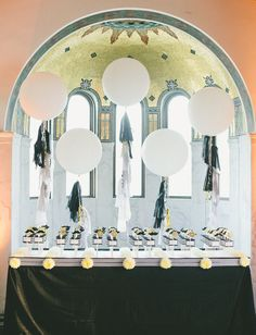 giant balloon with tassels escort card display