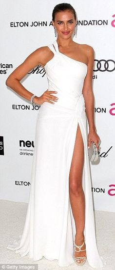 Irina Shayk's in a white dress complete with a thigh-high split at the Elton John AIDS Foundation's Oscar Viewing Party, 2012
