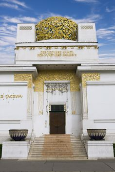 """The Secession Building, Vienna. Designed by architect Joseph Maria Olbrich, the white cubic building was constructed as an exhibition hall for the artists and designers of the Secessionist movement. The structure, which opened in 1898, is topped with a distinctive dome of gilt wrought-iron laurel leaves."""