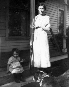 A Mother, her baby, the dog and a Shot Gun