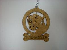 Schnauzer wood dog ornament with paw print hanging by GiftWorks. BUY NOW $8.95 with FREE SHIPPING!