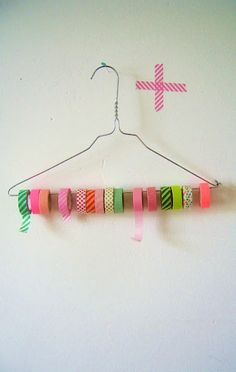 DIY Tape & Ribbon Holder Another alternative use for those wire hangers! Cut one end with wire cutters and loop them with pliers. Now you can open it up to easily store ribbon and washi tape. Washi Tape Storage, Washi Tape Crafts, Ribbon Storage, Washi Tapes, Diy Ribbon, Craft Room Storage, Craft Organization, Storage Ideas, Ribbon Organization