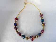 Collier perles diverses structure et patine