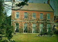 Amcott House from the garden. Taken April 1912  Half of a stereoscopic autochrome by S. Pegler.