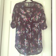 Express size L navy tunic Sheet navy tunic with pink, tan, green, and blue flower print. Long sleeves but can be rolled to 3/4 sleeves as shown in the photo. Loose and flowy, buttons up the front. No snags or stains. EUC! Express Tops Tunics