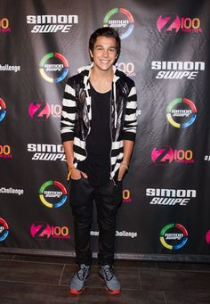 Friday, July 11: Austin Mahone looked so cool posing on the red carpet meet and greet for the Simon Swipe Presents Austin Mahone Live event at the iHeartRadio Theater in NYC. We love his totally stylish black and white striped hoodie and colorful sneakers!
