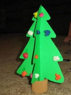 A Christmas Tree made out of construction paper with tissue paper ornaments