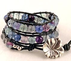 Belky's Bracelets - Leather beaded wrap bracelet in black leather featuring rainbow fluorite beads. Triple wrap bracelet. Also includes a pansy flower shaped button closure.