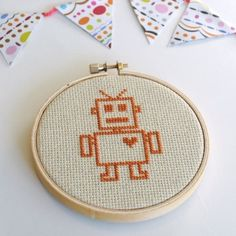 Want to relearn the craft. This is a cute starter. Robot cross stitch, nice and simple as its all in one colour  Inspiration - something different for embellishing boy pages?