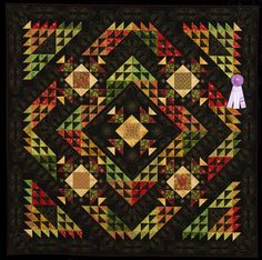 2015 Quilt Expo Quilt Contest, Honorable Mention, Category 3, Machine Quilted Bed Size Pieced: All That Glimmers..., Sharyl Schlieckau, Loganville, Wis. quiltexpo.com