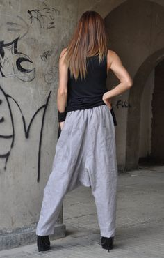 Loose Casual Drop Crotch Harem Pants. Incredibly comfortable wide pants, suitable for everyday use. Can be combined with a tight or wide tunic or a blouse, you will look extravagant and you will feel incredible. The pants have 2 sides. You can wear it on both sides.  ♥ THE PERFECT GIFT ever ♥ ♥ I wrap all garments in my Boutique in a special UNIQUE way ♥  Handmade in a Pet-free and Smoke-free environment.  Made of : 100% Linen The model wears size M - 5,6 / 170 cm Available Size: XS, S, ...