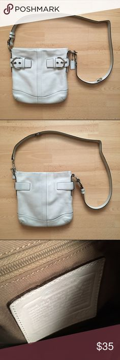 """Coach Crossbody Bag with Silver Hardware Authentic Coach bag. Previously loved Coach crossbody bag that needs a new home. No rips or tears, but the bag shows wear on its color. Some blue staining on the back and overall wear in color mostly on the back, bottom, and inside top of the bag. 11"""" W x 10.5"""" L x 1.5"""" D. Top zipper, inside zipper compartment, and two interior pocket compartments. Make an offer! Coach Bags Crossbody Bags"""