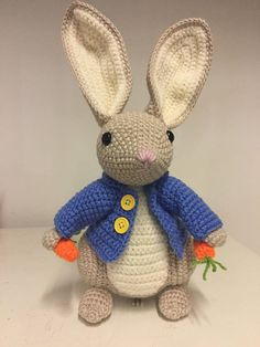 This bunny is an original design inspired by Peter Rabbit. He stands 31cm. He has a fluffy tail, long ears, blue jacket and is holding carrots. Ideal gift for Beatrix Potter fans.