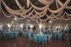 Draping is amazing and the tables are gorgeous for this Winter Wonderland themed event #winterwonderland #partytheme