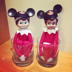 Elf on the shelf with Mickey ears on the Disney cruise. Elf friends. Mickey ears ornaments made the perfect hats for these two!