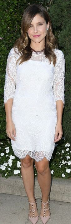 Who made Sophia Bush's white lace dress, jewelry, and nude stud pumps that she wore in Beverly Hills on October 14, 2012? Dress – Katherine Kidd  Shoes – Valentino  Earrings – Roseark  Necklace – Vintage