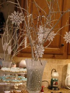 branches with  snowflake ornaments.   this has several ideas