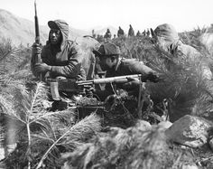 A machine gun crew of Company A, 24th Regiment, 25th Infantry Division near the Han River, 21 Feb 1951.
