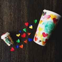 For All: A double-walled ceramic mug featuring a heart of every hue in watercolor style, part of the Starbucks Dot Collection. @Starbucks