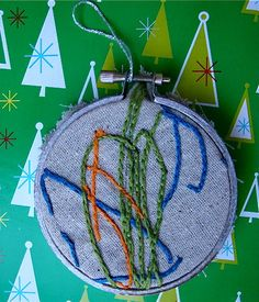 Baby scribbles ornament  http://vickiehowell.blogspot.com/2010/12/lark-crafts-post-embroidered-baby-art.html