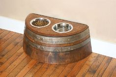 Compliment your home's decor with this unique Wine Barrel Raised Dog Feeder. It is hand-crafted out of authentic wine barrel staves and a recycled oak barrel head. This Wine Barrel Dog Feeder includes Two, 3 cup each stainless steel bowls. Dog Feeding Station, Dog Station, Raised Dog Feeder, Wine Barrel Furniture, Barrel Projects, Diy Dog Bed, Pet Feeder, In Vino Veritas, Dog Houses