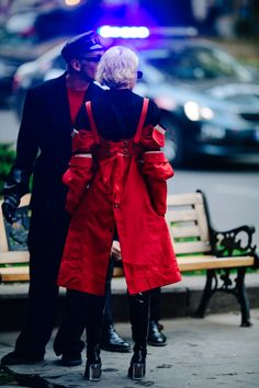 Couple wearing black and red outfits