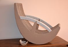 Cardboard chair project by Oksana Bedo, via Behance here's the link to a board full of cardboard furniture! http://www.pinterest.com/rosella28960/moveis-de-papelao/