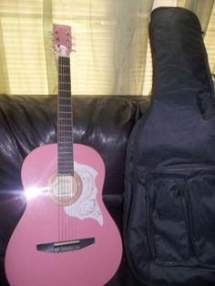 pink youth guitar w/tags   Brand:	Johnson  Dexterity:	Right-Handed	Model:	JG-100-PK  String Configuration:	6 String