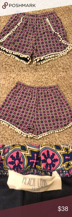 Boutique Pom Pom shorts Cute colorful Pom Pom shorts! Only worn a couple of times and in GREAT condition. All Pom poems are still connected. Peach Love Shorts