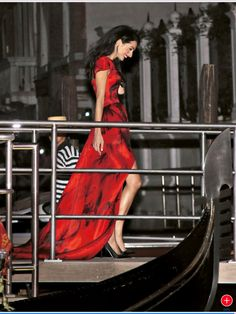 The night before her wedding, Amal Alamuddin wear a red Alexander McQueen gown