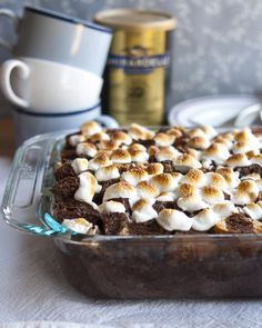 When we were kids, a day of winter romping was always — always! — followed by mugs of cocoa and a plate of buttered toast. This was a given. It was inconceivable that one would not be followed by the other. In the spirit of all things cozy and warm, I give to you this bread pudding. It takes the best of cocoa and the best of toast, and puts it in a single, custardy, marshmallow-topped dish. You can make it ahead in anticipation of a special winter breakfast or serve it for an post-dinner…