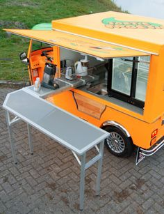 Smart slide out table for mini food truck - electric vehicle
