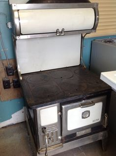 Antique wood stove at Chilliwack New and Used Building Materials Inc.