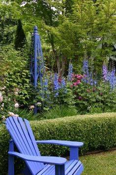 Personally, I think blue garden furniture is the best, because blue flowers tend to get lost.by that I mean they blend into the background and can be hard to see. Blue furniture is beautiful with pink and yellow flowers. Dream Garden, Garden Art, Garden Design, Blue Garden Furniture, My Secret Garden, Garden Structures, Garden Spaces, Beautiful Gardens, Beautiful Flowers