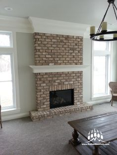 Here is the final version of Topaz Masonry's gorgeous fireplace in Raymond Alberta Canada. This fireplace was made with Cherokee Brick's Augusta color. www.KodiakMountain.com