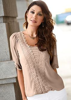 Facebook Share [Pin It] 	   	Add to Wishlist  	 	 Beige (BE) Lace Detail Top $39 There's no better way to look and feel like a woman than a billowing lace top. ·  	Blouson waist   ·  	Polyester/cotton   ·  	Imported  ·  	Style #J3951