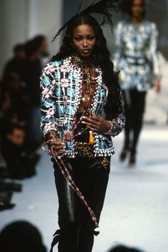 a417e49979bf 1992 Naomi Campbell in a colorful tweed jacket with nothing underneath,  complete with a massive