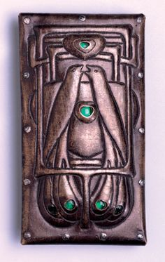 TALWIN MORRIS 1865-1911 An exceptionally rare buckle Aluminium Paste H: 7.5 cm (2.95 in) W: 4 cm (1.57 in) Scottish, c.1900