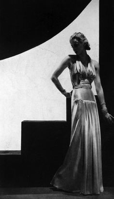 Vogue UK, 1938. According to http://fashionbloglife.com/1930sfashion/?doing_wp_cron - in the 1930s, 'Necklines started to plunge and waistlines were of a more sensuous shape accentuating the female silhouette'.