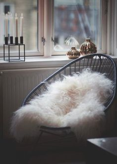 Black acapulco chair with sheep skin