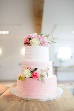 Lovely soft pink ombre wedding cake with roses.