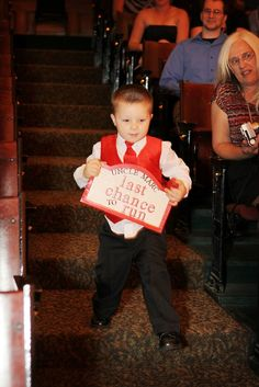 I am so glad my groom did not run when he saw our cute little ring bearer holding the sign I made...lol