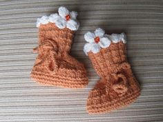 Looking for your next project? You're going to love Orange Booties with Cream Flowers by designer KnittinKitty. - via @Craftsy